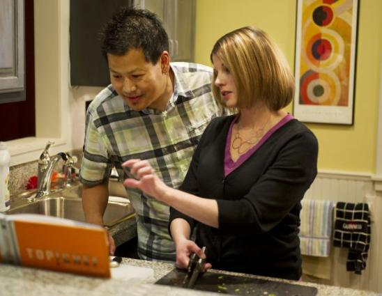 K and I Cooking a Meal Together in Our Kitchen. Courtesy of StarTribune.com