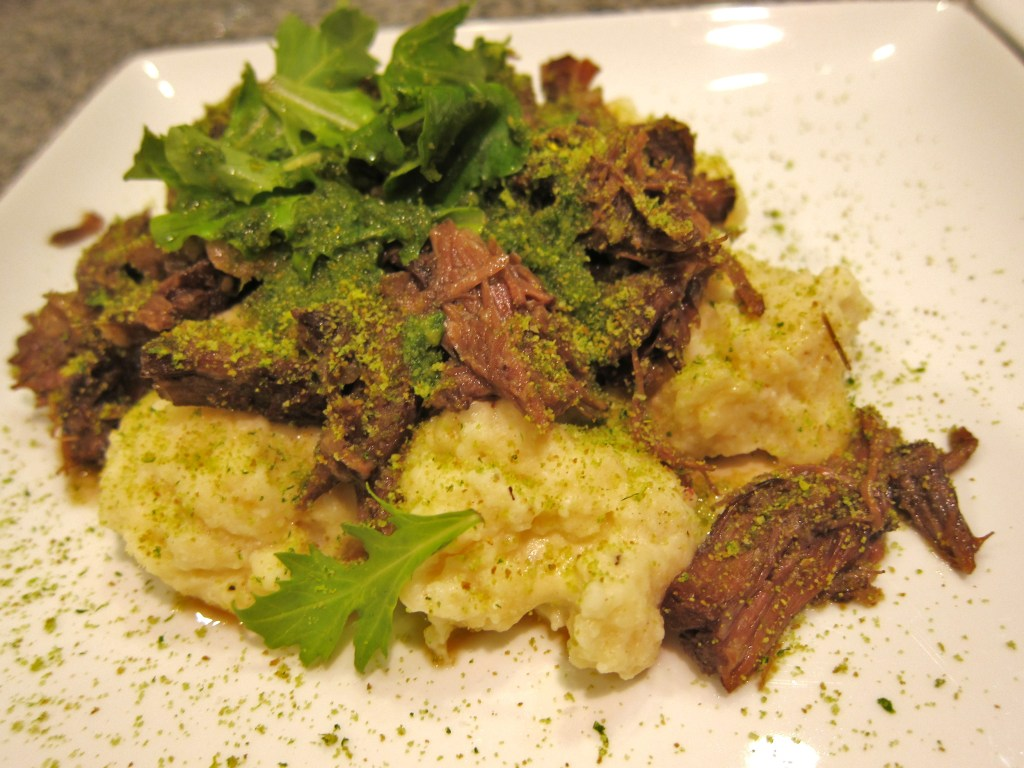 Ricotta gnudi with oxtail sauce